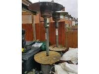 3 patio heaters with tables