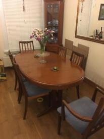 Stag table and 8 chairs. 2 corner units and a side board