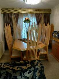 Dining table with 8 chairs and side board