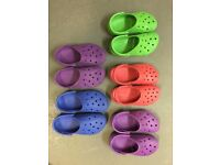 5 pairs of Crocs in assorted colours - in size M4/W6