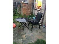 Garden table and chairs with umbrella.
