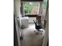 Large double room with its own private sink, study area and balcony!