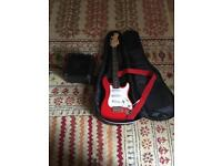 Volcano electric guitar with amp and case.