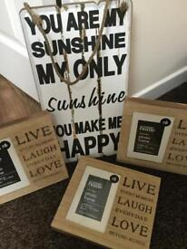 Wooden sign and photo frames