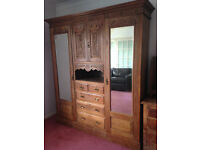 Satinwood Wardrobe triple, hanging, shelves and drawers. Matching chest of drawers. Sold separately