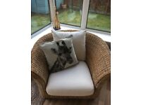 Sofa and chair with matching lamp tables. Blonde wicker with cream washable upholstery.