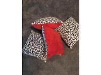 4 brand new animal print and orange cushions