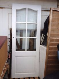 White wooden door with wavy glass panels, Southbourne