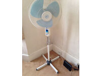 White stand fan with adjustable height