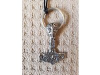 Large Thor's hammer pendant on original string with fastener in excellent condition.