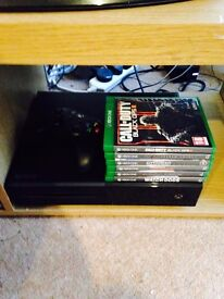 Xbox one like new with controller and 6 games.