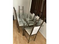 Glass dining table and 6 chairs Excellent Condition