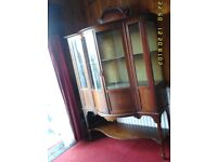 Beautiful, ornate, bow fronted china / display cabinet. Lockable interior - key included.