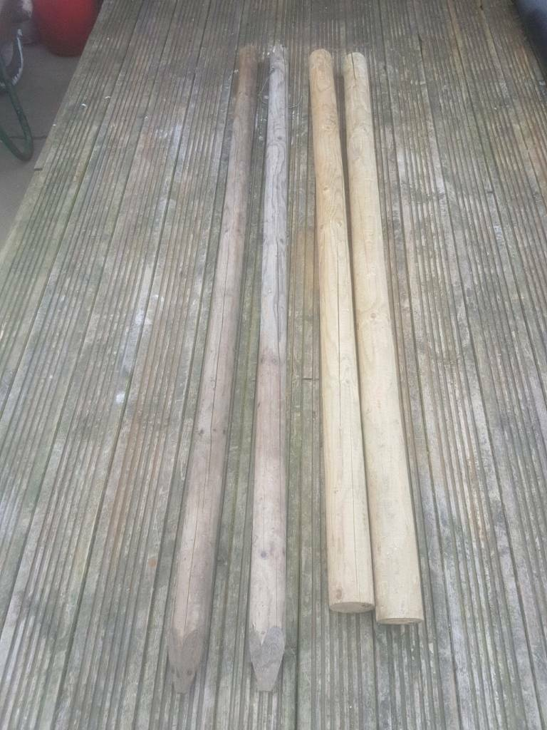 Wooden round posts over 5f long