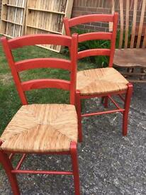 Lovely Pair Of farmhouse chairs red with rush seats excellent condition