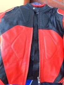 Motorbike jacket. Black and red, size S