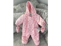 Baby girls snowsuit. First size
