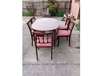 Dark Wood Oval Extendable Dining Table With 6 Chairs