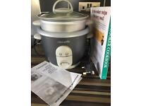 Rice cooker and recipe book