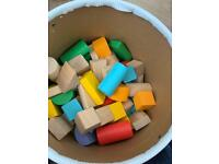 Tub of wooden blocks and block board