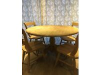 Lovely solid dining table and 4 chairs. Drop leaf with a beautiful carved pedistal.