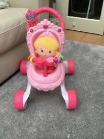 Baby Walker- Fisher Price musical pushchair and doll