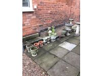A job lot of 15 ornate stone Urns Troughs and Pots