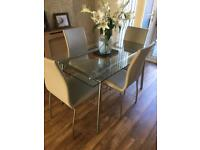 Glass table and 4 cream chairs