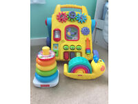 baby walker and two fisher price toys