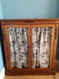 Glass door oak cabinet