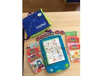 Leap Pad from Leap Frog Interactive computerised learning system for young children.