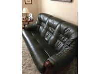 3 piece green leather suite set in oak frame. Couch in as new condition, chairs ok