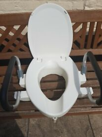 Raised toilet seat for elderly with arms