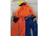 Ski jacket, ski pants, salopettes, gloves and helmet.