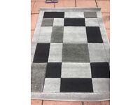 Brand new grey/black rug