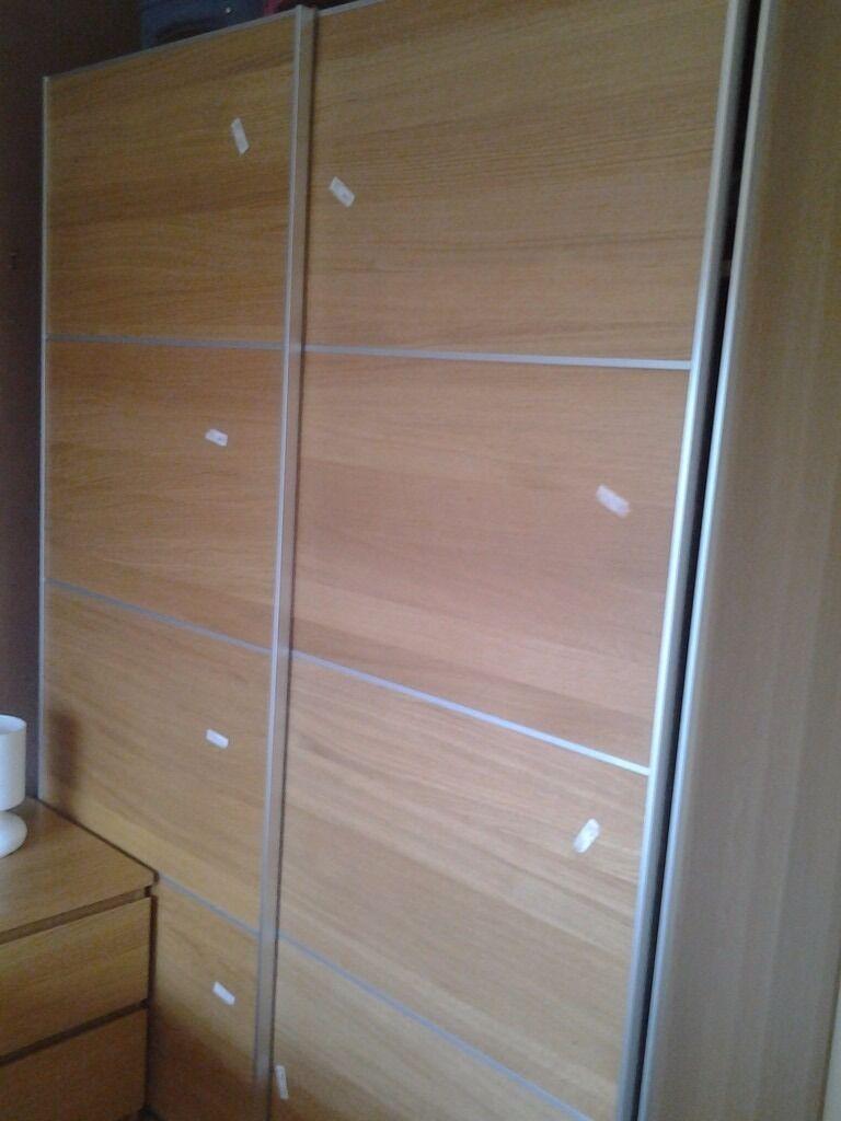 Wardrobe With Pair Of Sliding Doors In Oak Veneer Pax