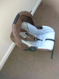 Brown baby carrier for sale only 20 pounds