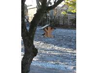 Handcrafted wooden hanging bird feeder