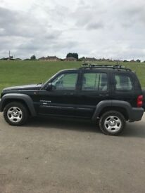 Jeep sport Cherokee 2.4 in Jet Black