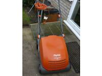 Flymo Lawnraker 340 compact 750W. Removes thatch and leaves for a healthy lawn