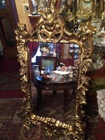 Large ornate wooden mirror