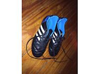 Children's adidas football boots and Nike shin guards