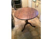 "Mahogany tilt top side table, round birdcage design. 28""h x 30""d."