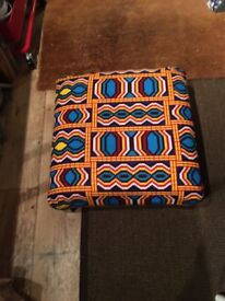 Genuine African fabric covered foot stool/ prayer stool/ coffee table