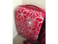2 small carry on suitcases