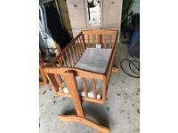 Wooden swinging baby crib