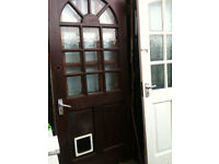 Exterior hardwood door with crazed glass squares and cat flap