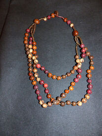 TAGUA NUT MULTIPLE STRAND, BEADED NECKLACES FROM ECUADOR.