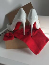 White size 6 loubouton shoes.
