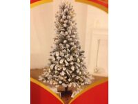 1.8m(6ft) x 1.06(3ft) fake snow covered tree with hinged branches used once.
